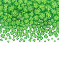 Vector green falling clovers isolated on white background