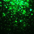 Vector green glowing light glitter background. Magic glow light effect. Star burst with sparkles on dark background