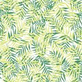 Vector green palm leaves seamless pattern background.