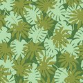 Vector green tropical leaves seamless pattern background