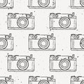 Vector grunge black and white vintage seamless pattern with retro photo cameras