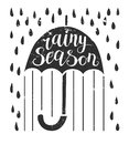 Vector grunge lettering poster with an umbrella and rain