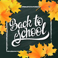 Vector hand lettering greeting text - back to school - with chalk frame and realistic maple leafs on blackboard