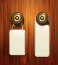 Vector hotel handles with hanging signs on the wooden background Royalty Free Stock Images