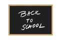 Vector illustration of black school board with handwritten text Back to school isolated