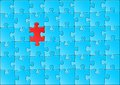 Vector illustration of a blue jigsaw puzzle with one red piece Royalty Free Stock Images
