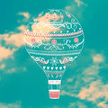 Vector illustration with decorative hot air ballon in blue sky Royalty Free Stock Photo