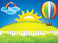 Vector illustration of hot air balloon and green grass meadow Stock Image