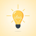 Vector illustration. Light bulb with the word of idea and rays shine.