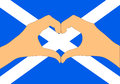 Vector illustration of Scotland flag and hands making a heart shape