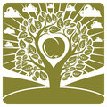 Vector illustration of tree with leaves and branches in the shape heart an apple inside placed on landscape clouds Royalty Free Stock Photography