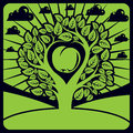 Vector illustration of tree with leaves and branches in the shape heart an apple inside placed on landscape clouds Royalty Free Stock Photo