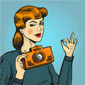 Vector illustration of woman taking photo in pop art style. Royalty Free Stock Photo
