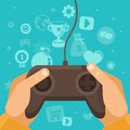 Vector online game concept hands holding joystick with wire and gamification icons in flat style on blue background Royalty Free Stock Photos