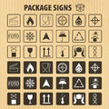 Vector packaging symbols on  cardboard background. Shipping icon set including recycling, fragile, the shelf life of the pro Royalty Free Stock Photo