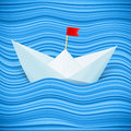 Vector paper boat in blue waves of sea Stock Photo