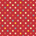 Vector pattern with colorful polka dots in green, yellow, brown and pink on red background Royalty Free Stock Photo