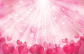 Vector pink background with lights, rays and  hear Royalty Free Stock Photo