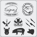 Vector pork meat labels and design elements. Butcher`s business logos. Silhouettes of pig and cutlery.