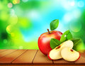 Vector ruddy apple with apple slices lying on a wooden table on