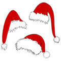 Vector santa hats Stock Images