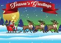 Santa ride sleigh with his reindeers in the middle of snowy winter Royalty Free Stock Photo