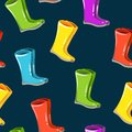 Vector seamless autumn,fall pattern,texture,print. Rainy colorful boots on the dark background