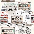 Vector seamless background with old cassette headphones notes bi Royalty Free Stock Photo