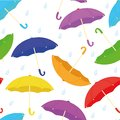 Vector seamless background with various colorful umbrellas with rain drops flat cartoon style on a white background