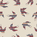 Vector seamless decorative ethnic pattern with swallows Royalty Free Stock Photo