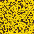 Vector seamless flat hand drawn dog pattern with bones, hearts, paw trace different sizes isolated on yellow background.