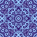 Vector seamless pattern with bright blue ornament. Tile in Eastern style. Ornamental lace tracery. Ornate swirl geometrical decor