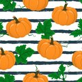 Vector seamless pattern with cartoon pumpkin on stripped background.