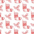 Vector seamless pattern of Christmas decorative symbol - sock and holly. Christmas decorative texture of red stocking and holly Royalty Free Stock Photo