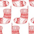 Vector seamless pattern of Christmas decorative symbol - sock. Christmas decorative texture of stocking on white background Royalty Free Stock Photo