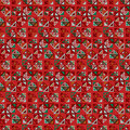 Vector seamless pattern. Consists of geometric elements on red background. The elements have a triangular shape.