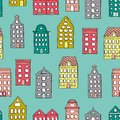 Vector seamless pattern with cute houses on blue background