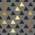 Vector seamless pattern with golden triangles. Decorative background for printing