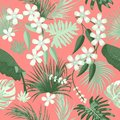 Vector seamless pattern with green tropical leaves on Living Coral color background