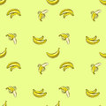 Vector seamless pattern with hand drawn bananas on a Light green background.
