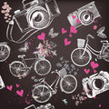 Vector seamless pattern with hand drawn bicycles and hearts Royalty Free Stock Photo