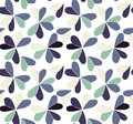 Vector seamless pattern with hearts placed in clover shapes. Flat shamrock imagined colors background. Simple repeating