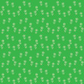 Vector seamless pattern, little flowers on green Royalty Free Stock Images