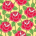Vector seamless pattern with old school rose flower in red, green leaves and stems on the yellow background.