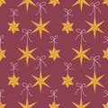 Vector seamless pattern with orange origami star Christmas ornaments hanging on ribbons with bows on red background. Fun Royalty Free Stock Photo