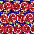 Juicy halves of pomegranate on blue background. Pattern. Vector illustration Royalty Free Stock Photo