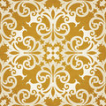 Vector seamless pattern with swirls and floral motifs in retro style golden victorian background it can be used for wallpaper Royalty Free Stock Photo