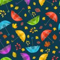Vector seamless pattern, texture with colorful umbrellas and leaves. Autumn design. Cartoon, cute print.