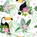 Vector seamless pattern with toucan birds on tropical branches with leaves and flowers