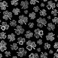 Vector seamless pattern with white clover on black background
